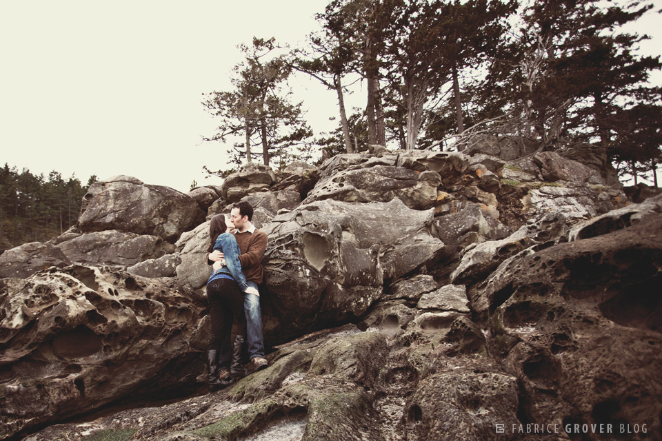 A couple kissing on the rocks on Saturna Island