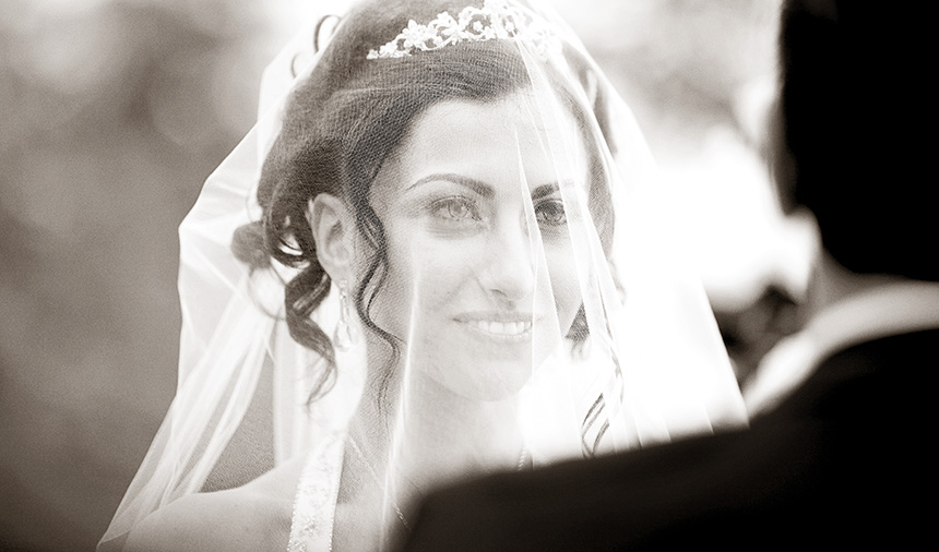 A bride signs the registry during her wedding on Grouse Mountain