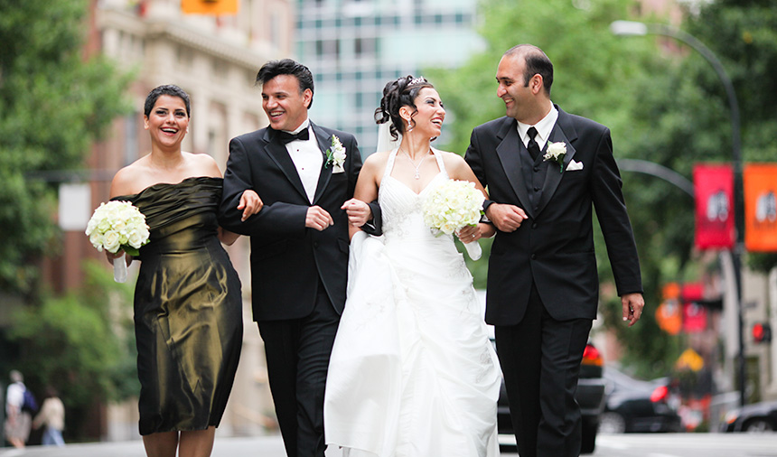 The wedding party walk down the street Downtown
