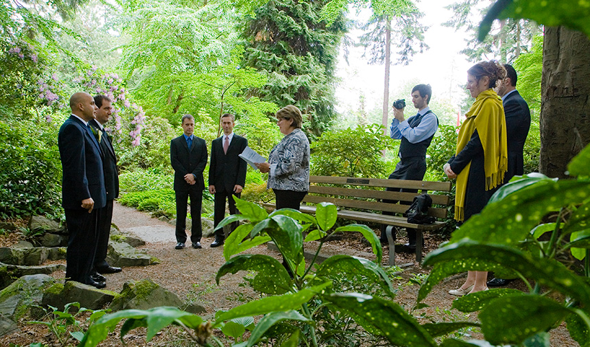 Same-sex wedding photography in forest near Stanley Park Pavillion Vancouver BC Canada