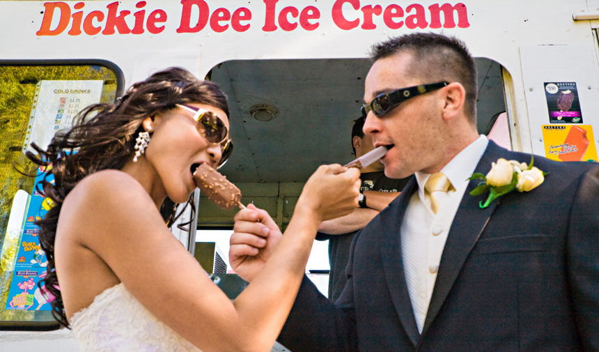 Vancouver wedding photography couple eat ice-cream at Jericho beach duck pond in Vancouver BC