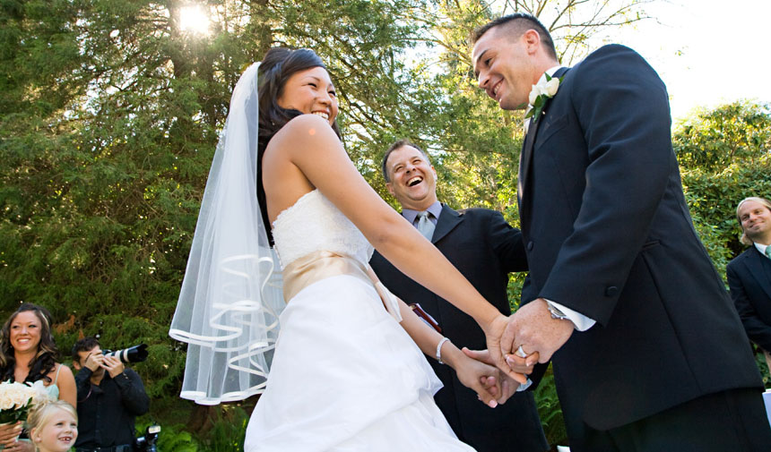 Couple celebrates after getting married at Aberthau wedding with Vancouver photographer