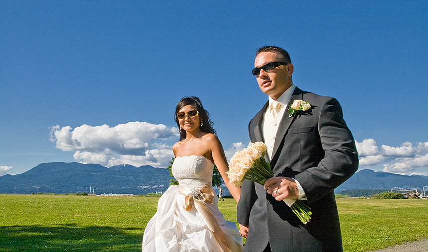 Newlyweds enjoy Vancouver wedding photography near Spanish Banks on Jericho beach