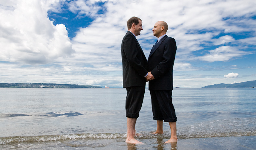 Same-sex couple marriage vows in the ocean in the heart of the West End of Vancouver BC
