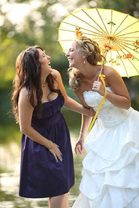 vancouver wedding photographer bride and maid of honour laughing by lakeside dock in White Rock