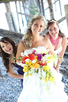 vancouver wedding photographer bridesmaids play under the dock on the beach in White Rock BC