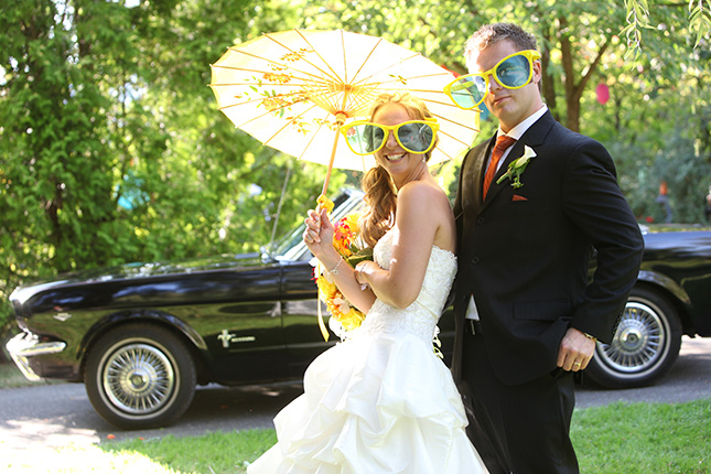 vancouver wedding photographer funny couple wear oversized glasses in front of their vintage car