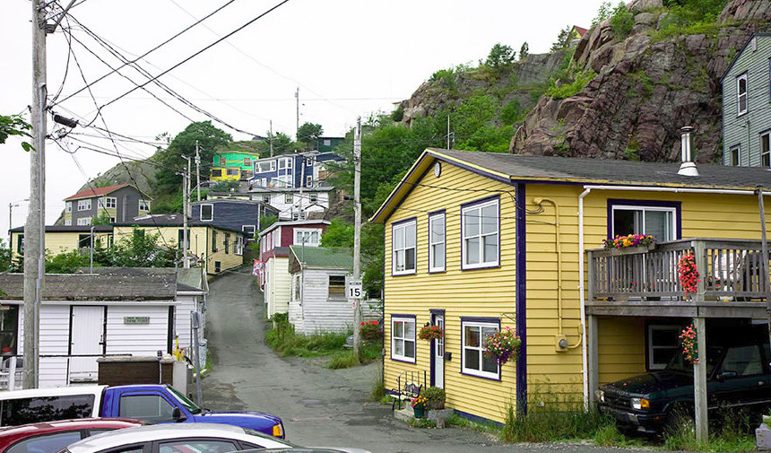 Houses crowd along the bluffs in St John's